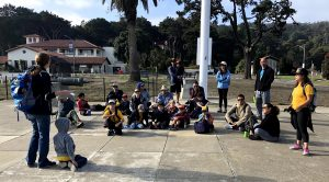 Pack 104 seated listening to a guide talk at the Presidio